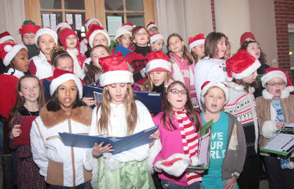 Local students sing Christmas carols on the steps of the old courthouse.