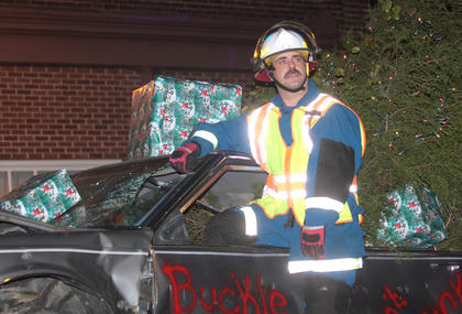 John Skaggs rides the float for the Marion County Rescue Squad, which promoted safe driving during the holidays.