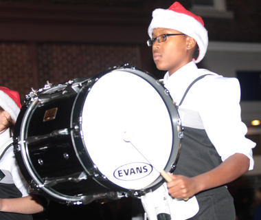 Paris Manson of the Marion County High School Marching Knights plays the drums during the Dickens Christmas parade.