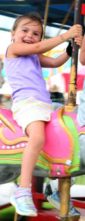 Riley Deering is all smiles on the carousel.
