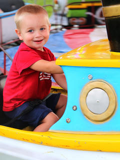 Layton West gave a big smile as he rode the boats at the fair.