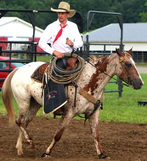 Arthur Antonides, member of the traveling rodeo, got ready for the night's event.