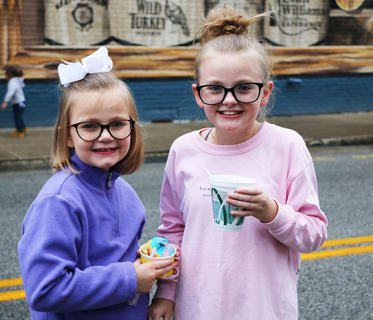 Carlie and June Ann Hill show off their sweet treats at Family Fun Night on Sept. 27.
