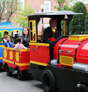 Lluvia and Mia Rodriguez (front) wave with Kelly and Isabella Brooks (back) from their train car at Family Fun Night.
