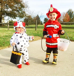 Hagan Evans and Avery Lynn Evans dressed as a fireman and his trusty Dalmatian for Halloween last year