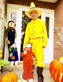 Eden Parman and her dad, Clint Parman, dressed as Curious George and the Man in the Yellow Hat during Halloween in 2016.