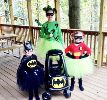 Carlie, Maddie and June Ann Hill dressed as Caped (and tutu-d) Crusaders during Halloween in 2014 at Lake Rudolph Campground in Santa Claus, Indiana.