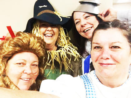 R.L. Schreiber coworkers Barb Battcher, Tammy Brady, Ellen Capua and Dottie Campbell transformed into the Wizard of Oz gang for Halloween.