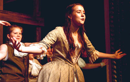 Riley Phillips as Angelica Schuyler, also pictured is Madison Honaker.