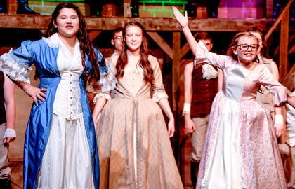 Shania Hallmark as Eliza, Riley Phillips as Angelica, and June Ann Hill as Peggy, the Schuyler Sisters.