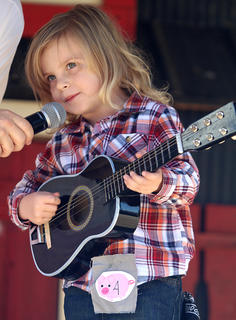 Colton Jase Hardin shows off his talents by playing the guitar during the Junior Farmer competition at the Marion County Country Ham Days Festival on Saturday morning. Apparently, he impressed the judges because he won the contest.