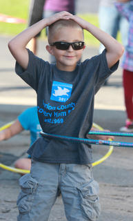 Jacobi Summers, 7, keeps his cool during the hula hoop competition.