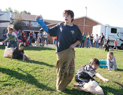 Will Fowler, 11, didn't let a broken arm stop him from winning the sack race.