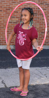 Mikenzie Calhoun, 5, waits for the hula hoop contest to begin.