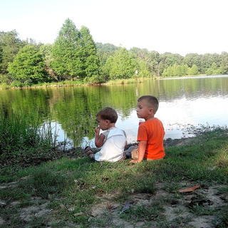 Andy and Tommy Cox fish at Sportsman's lake during a fishing trip this summer.