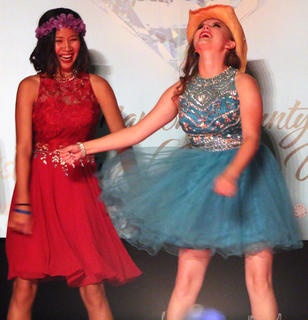 "Tessa Hillman, left, and Alivea Peake practice ""flossing"" while being silly on stage and waiting for the judges to finish deliberating."