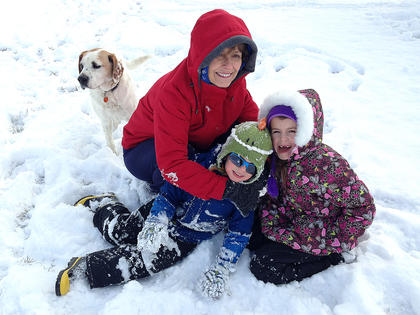 From left, family dog Cody, Mary Sue Lee (Mimi), Braxton and Addison Lee pose for a photo in the snow.