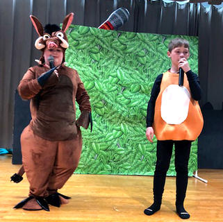 "Jayden Clark (Pumbaa) and Kolby Tucker (Timon) perform a scene from the movie ""The Lion King."""