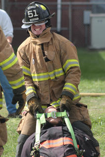 Levi Mattingly drags a 180-pound dummy for the Loretto Fire Department team during the obstacle/relay challenge.