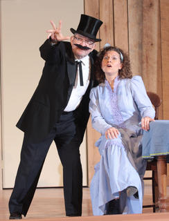 Filcher attempts to appeal to Amy Lovely (Stevie Lowery) to convince her to sell the ranch.