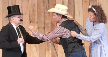 Hoot Galoot (Andy Colley) stands between Amy and the villainous Filcher.