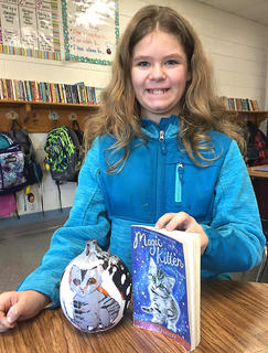 West Marion Elementary School student Macie Wood is pictured with her Magic Kitten-themed pumpkin.