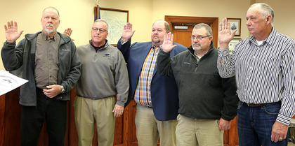 Pictured, from left, are Magistrates Larry Caldwell, John Arthur Elder III, Craig Bishop, Joe Pat Kirkland and Jackie Fogle being sworn in.