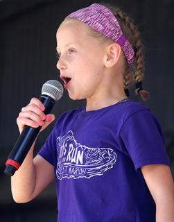 Mattie Riggs competes in the hog calling contest at the Marion County Country Ham Days Festival on Saturday afternoon. She was the female winner of the competition.