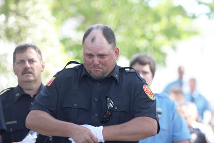 Charlie Harvey fights back tears during the funeral for Loretto Fire Chief Mark Mattingly. Mattingly died at his home June 14. He was 42.