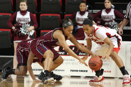 Senior Shakila Goodin steals the ball from Manual junior Leasia Wright.