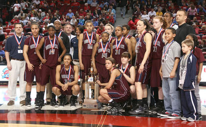 The Marion County Lady Knights pose with their state semifinalist trophy after Saturday's game.