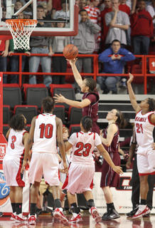 Makayla Epps gets a shot in the closing seconds against Manual.