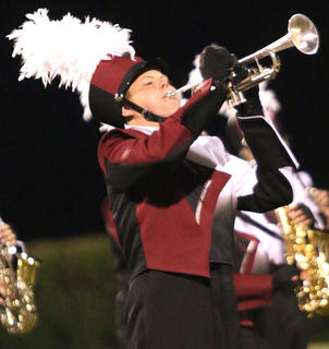 """Caleb Mattingly plays the trumpet during the Marion County High School band's show """"Exodus"""" on Saturday in the Marion County Marching Knights Festival."""
