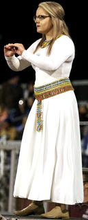 """Field Commander Mattie Bartley directs the Marion County High School band during their show """"Exodus"""" on Saturday in the Marion County Marching Knights Festival."""