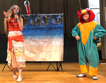 "Kinzlee Ford (Moana) and Landon Spalding (Chicken) perform a scene from the movie ""Moana."""