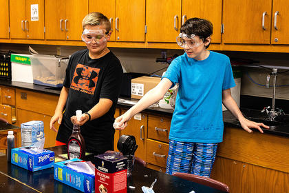 Nolan Hamm and Caleb Brown create chemical reactions. Mythology and the Past and Science Enrichment Camp teamed up with the Destination Science Camp for some fun experiments at the Marion County Knight Academy.