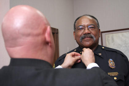 Mayor Gary Crenshaw pins Joe Bell as the new Lebanon Police Chief. Bell, an officer since 1975, is the first African-American to serve as the city's chief of police.