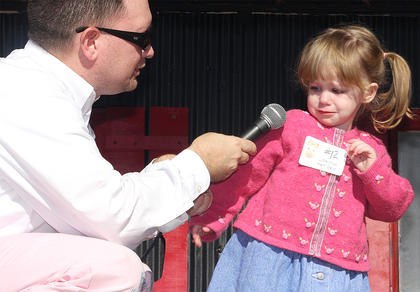 """Participant No. 12, Lillian Anneliese Shea, was frightened of emcee Jeremy """"Breakfast Boy"""" Bowman during the Little Miss Ham Days pageant. She's the daughter of Crystal and Mark Shea."""
