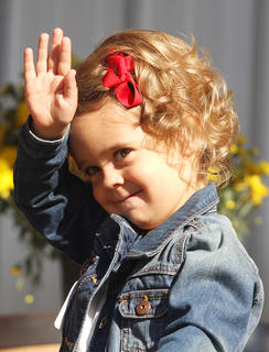 Participants No. 1, Lila Grace Bickett, waves to the crowd during the Little Miss Ham Days contest. She's the daughter of Jamie and Jessica Bickett.