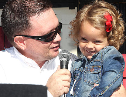 Lila Grace Bickett talks to emcee Jeremy Bowman during the Little Miss Ham Days contest. She's the daughter of Jamie and Jessica Bickett.