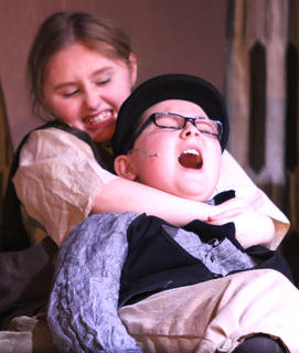 Oliver, played by Lilly Hager, attacks Noah Claypool, played by Joseph Hickey, who insulted Oliver's deceased mother.