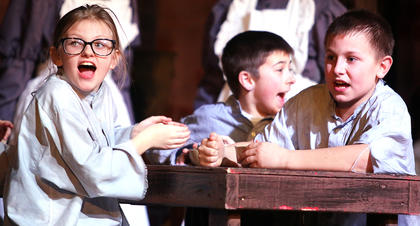 June Ann Hill, Hunter Newton and Jackson Knopp all play hungry orphans in the musical.