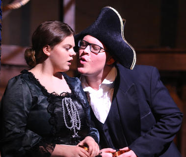Mr. Bumble, played by Clayton Tungate, attempts to give Mrs. Corney, played by Lilly Clark, a kiss.