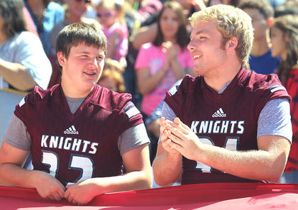 Pictured are J.T. Lee, left, and Mason Brown, members of the Marion County High School football team. The team helped carry a gigantic American flag at the start of the Pigasus Parade during the Marion County Country Ham Days Festival on Saturday afternoon.