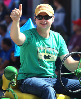Trey Abell gives a thumbs up to Pigasus Parade announcer Charles Lancaster Sr.