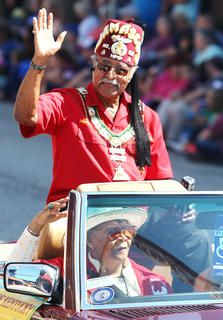 Jerry Evans waves to the crowd during the Pigasus Parade.