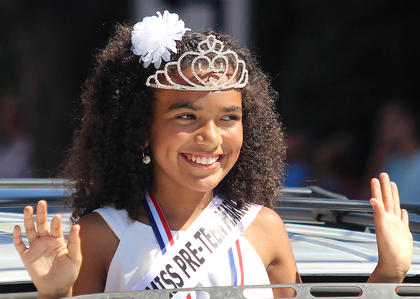 Ariyana Spalding, Marion County Fair Miss Pre-Teen, waves to the crowd during the Pigasus Parade.