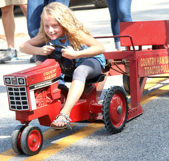 Maddie Riggs is determined to finish strong at the Pedal Pull competition on Sunday at Ham Days.