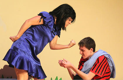 Stevie Lowery, as Lucy Van Pelt, shows her little brother, Linus, played by Chance Hovious, who is boss.