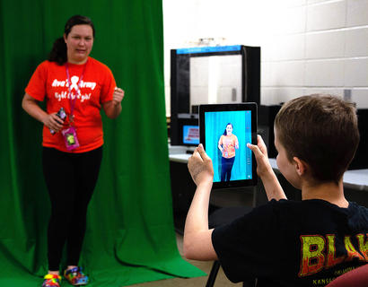 Madison Lee poses in front of the green screen. Ginger Allen'sPhotography/Graphic Design Camp was a part of the Marion County Area Technology Center's summer program June 3-5.